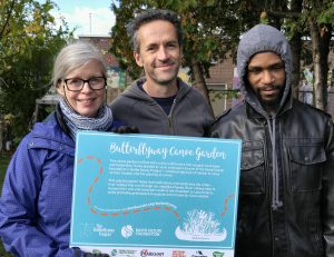 volunteers with butterflyway sign