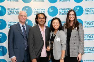 Photo of Storefront Staff accepting CUI award on Anne's Behalf